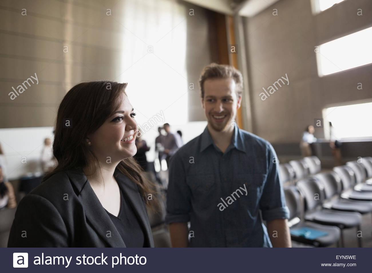 Smiling students in auditorium - Stock Image