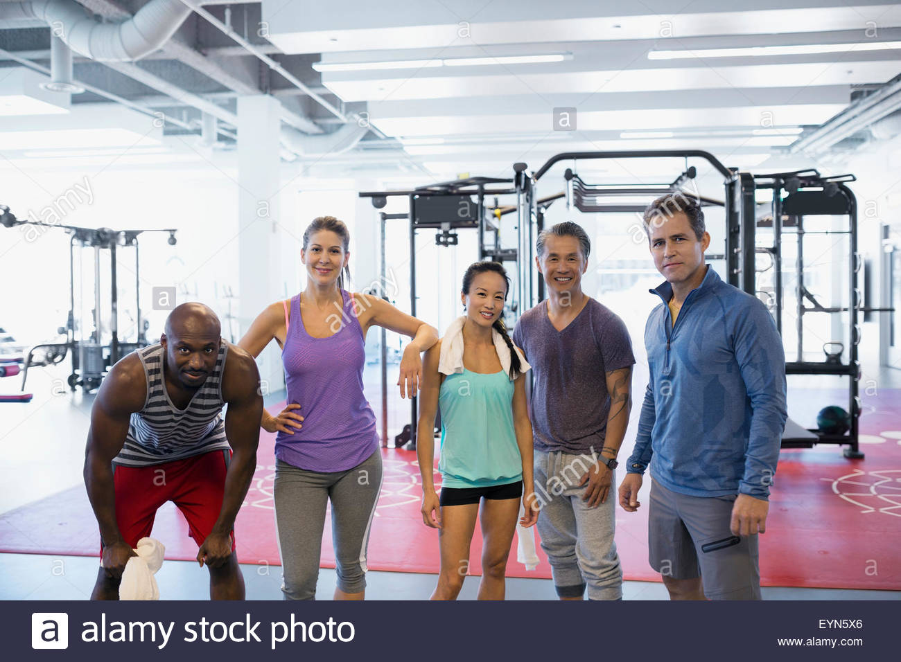 Portrait confident friends at gym - Stock Image