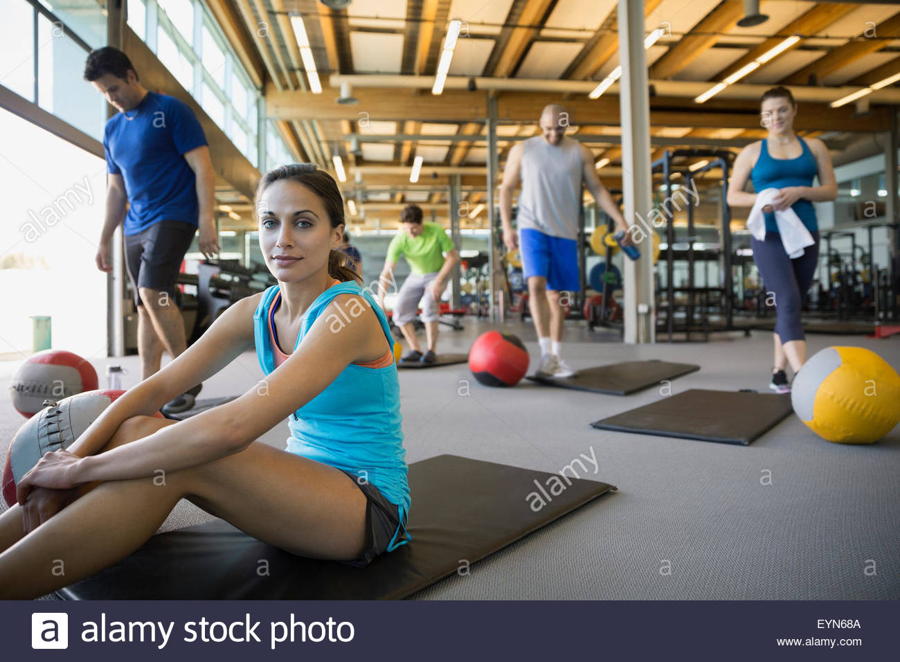 Portrait woman on mat ready for exercise class - Stock Image