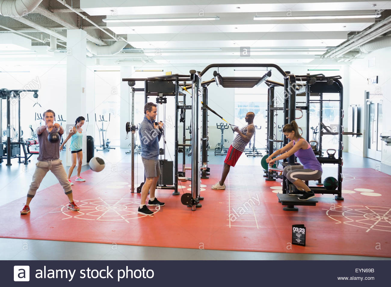 People exercising in gym - Stock Image