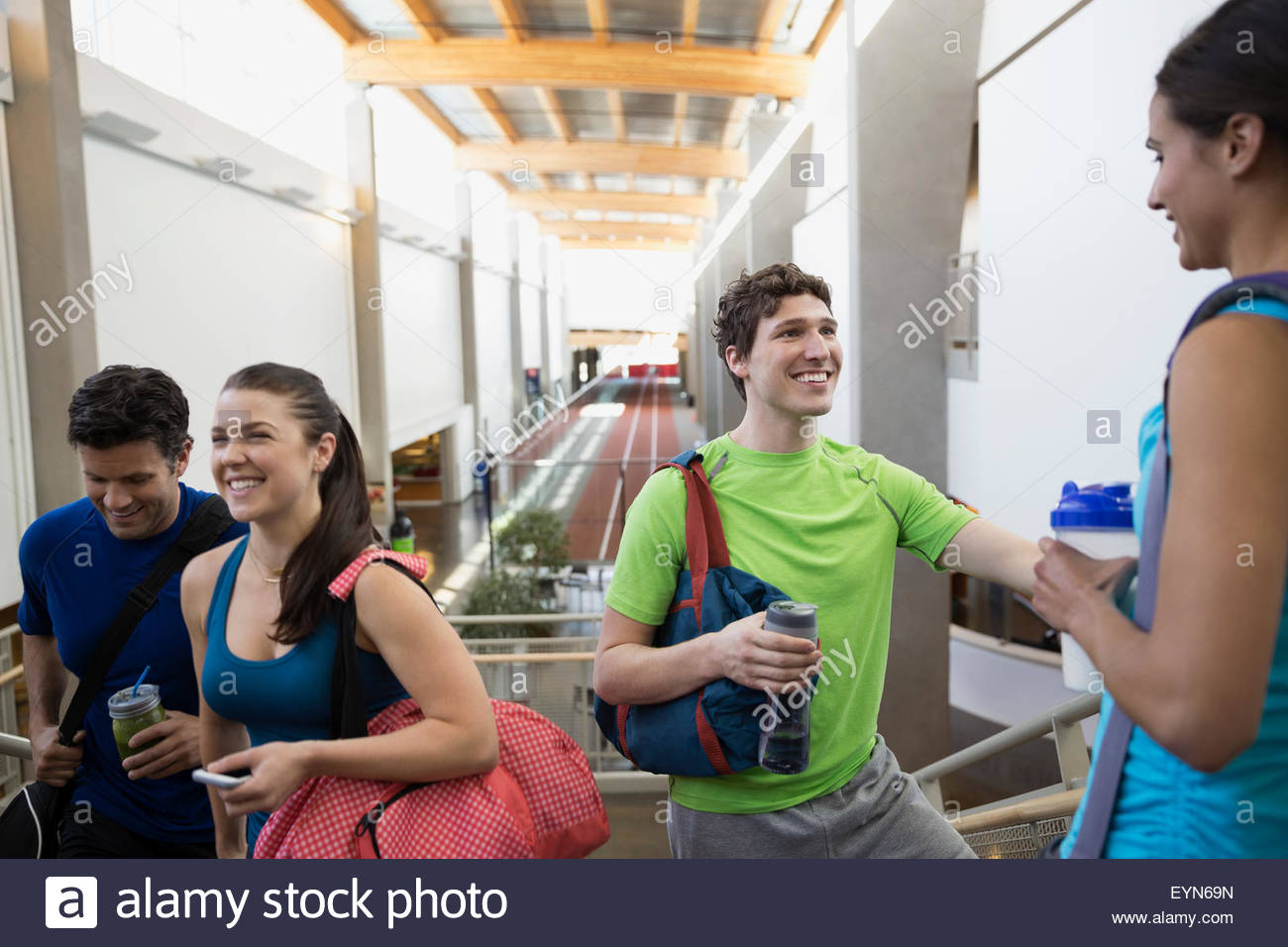 Friends talking at gym - Stock Image