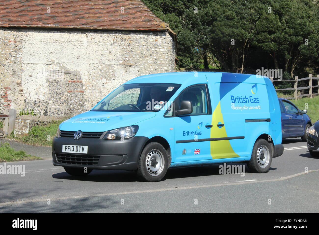 A small British Gas 2013 VW van travelling along a main A road in East Sussex carrying the full livery as correct - Stock Image