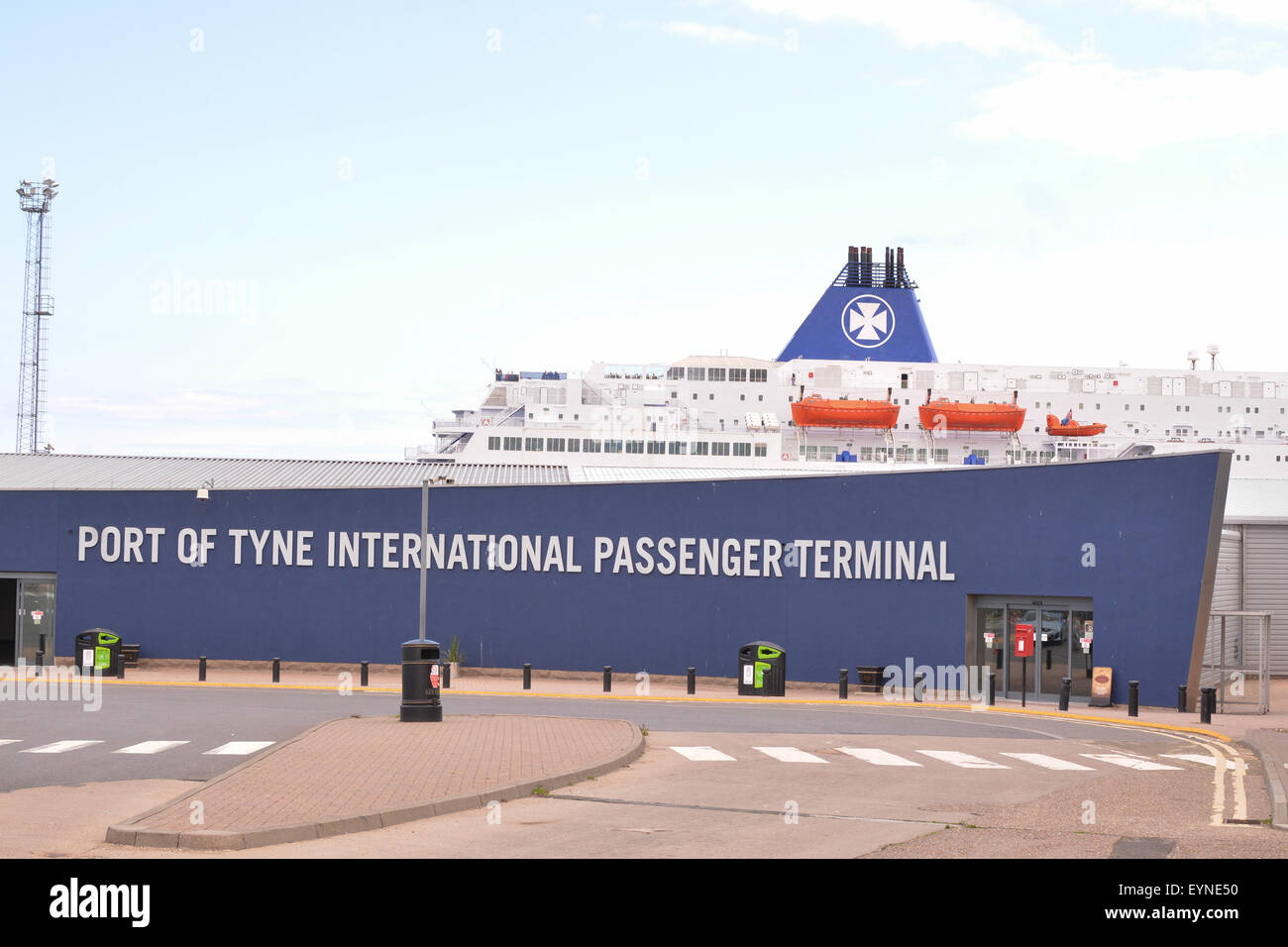 Port of Tyne International Passenger Terminal sign, with DFDS seaways ferry behind, Newcastle, England, UK - Stock Image
