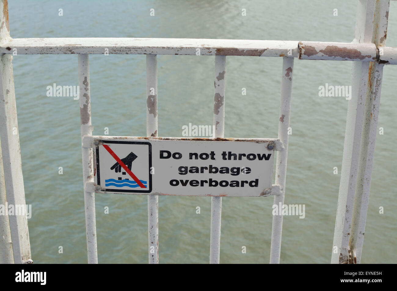 Do not throw garbage overboard sign on board passenger car ferry - Stock Image