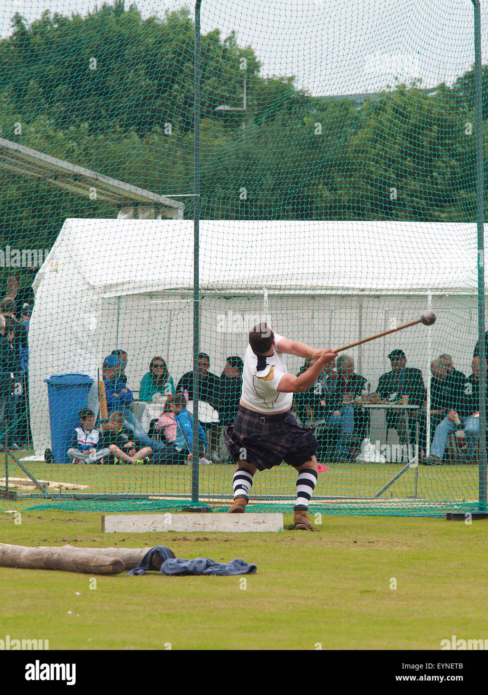 St. Andrews, Scotland - July 26th 2015: A competitor performing in the Hammer Throw competition at the Highland - Stock Image