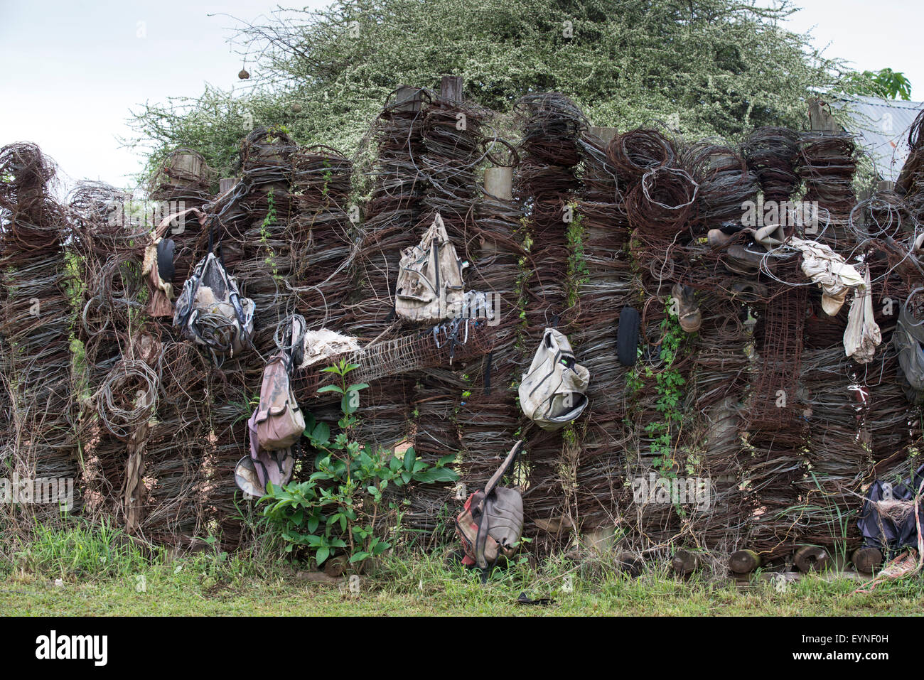 Display of wire snares and backpacks collected from poachers in Hlane National Park, Swaziland Stock Photo