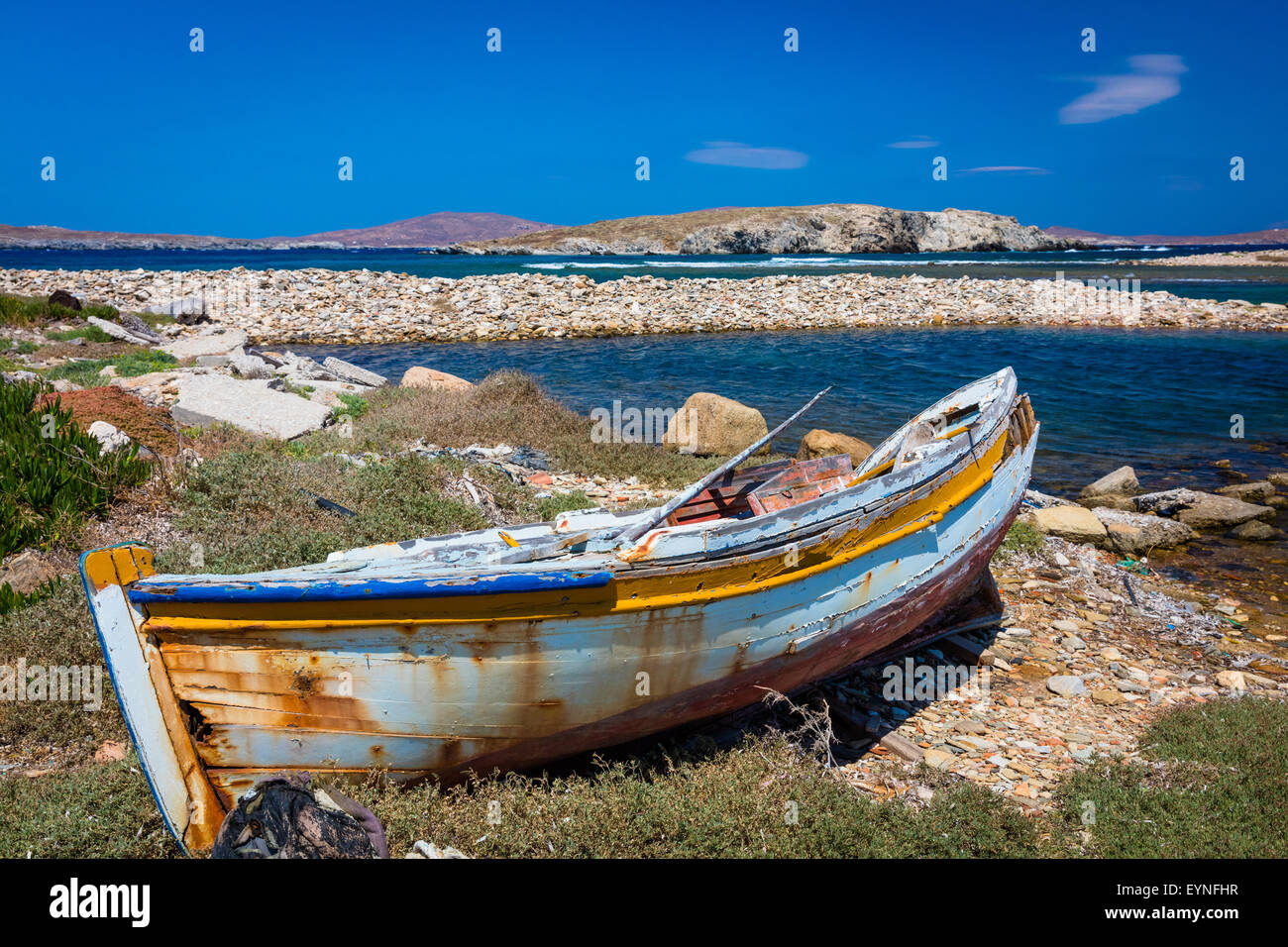 Dilapidated Greek boat in the Aegean Sea on the island of Delos - Stock Image