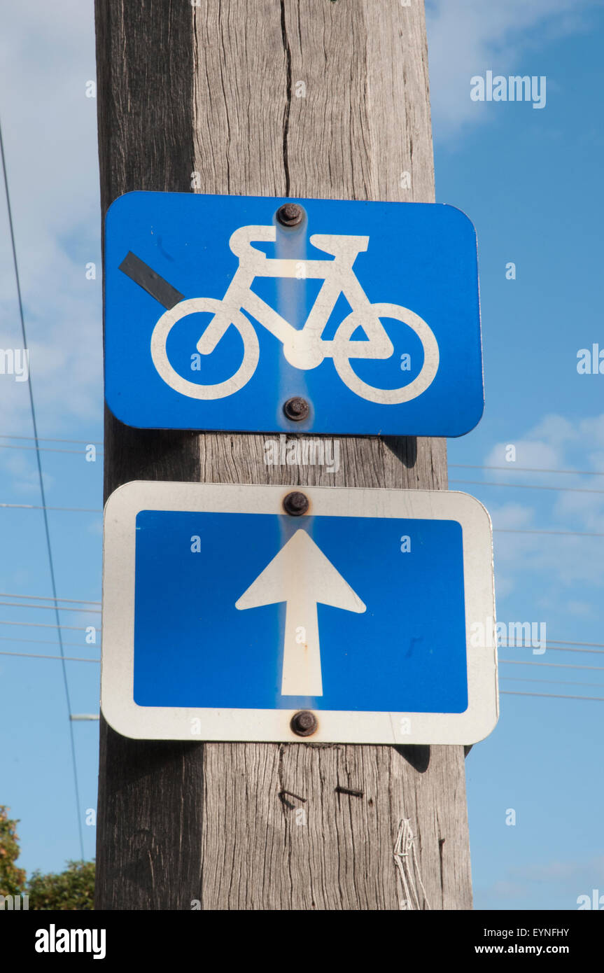 Markers indicate a preferred cycling route along an arterial road in suburban Melbourne, Australia - Stock Image
