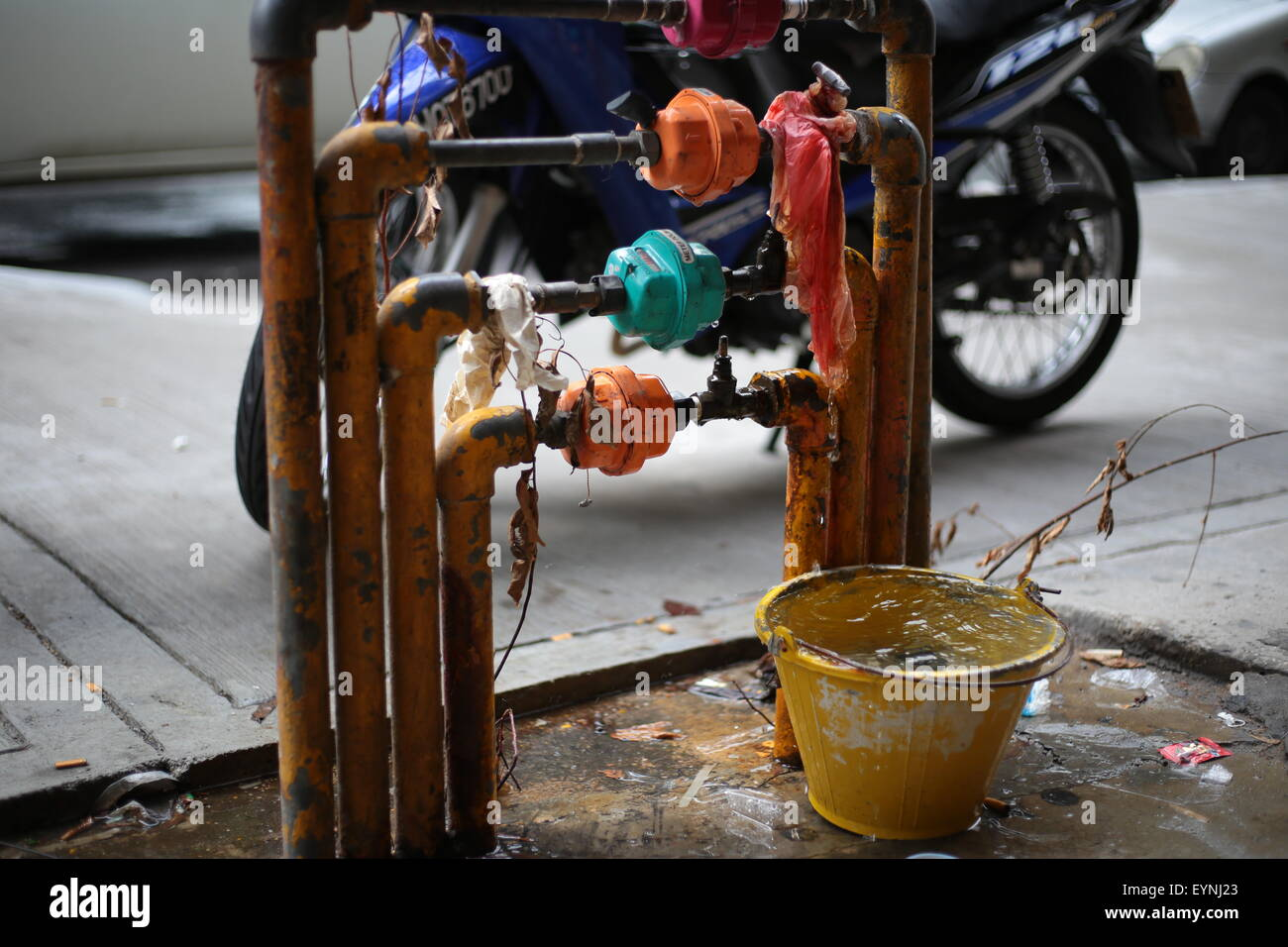 Water leakage from a pipe. - Stock Image