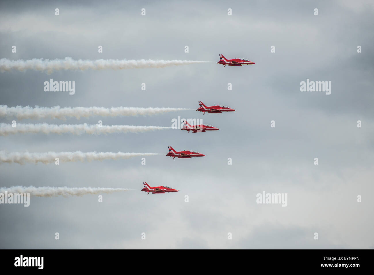 The Red Arrows, aerobatic display team performing in the skies above the Fairford International Air Tattoo - Stock Image