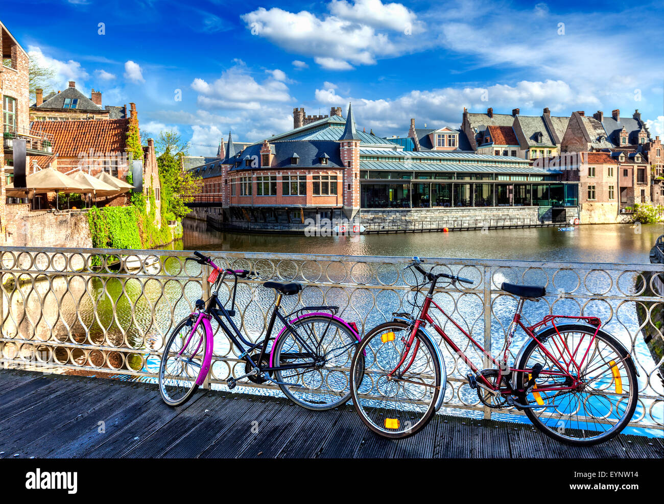 Bridge, bicycles and canal. Ghent, Belghium - Stock Image