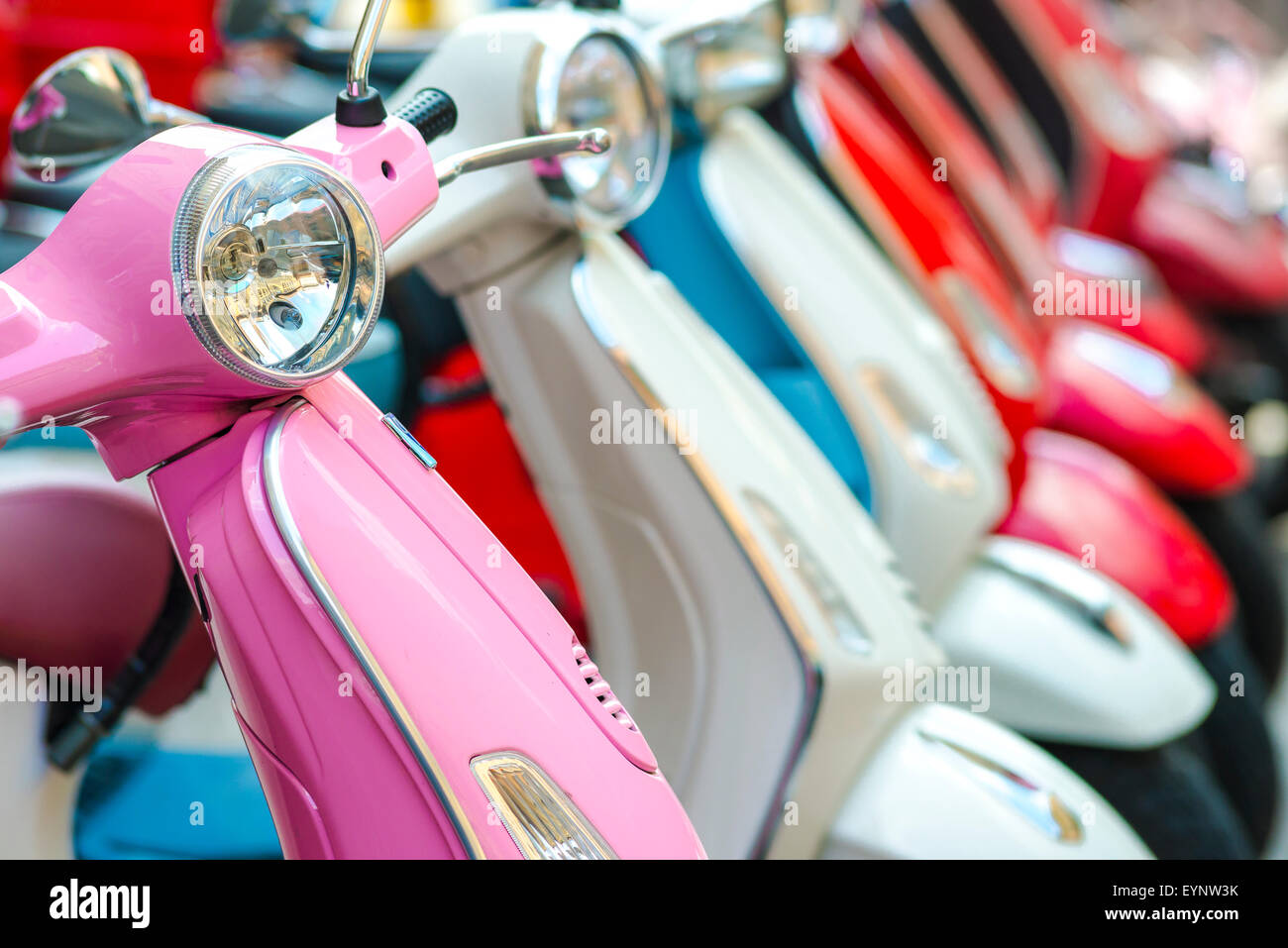 Scooter Rome, a line of colorful scooters parked in a street on the Aventine Hill in Rome, Italy. - Stock Image