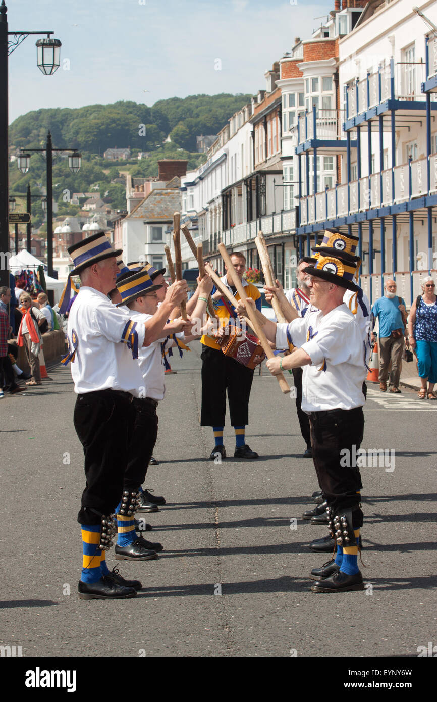 Morris Dancers and Mummers perform during the mass dance in Sidmouth Folk Week, 2015 - Stock Image