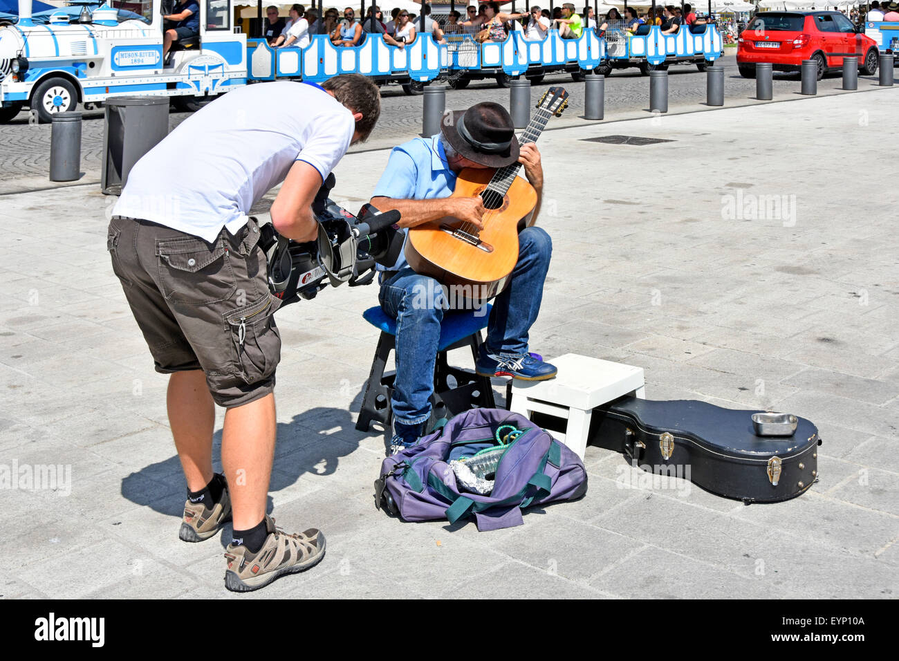 Marseille Vieux Port Marseilles Provence South of France cameraman filming guitarist on French touristy waterfront - Stock Image