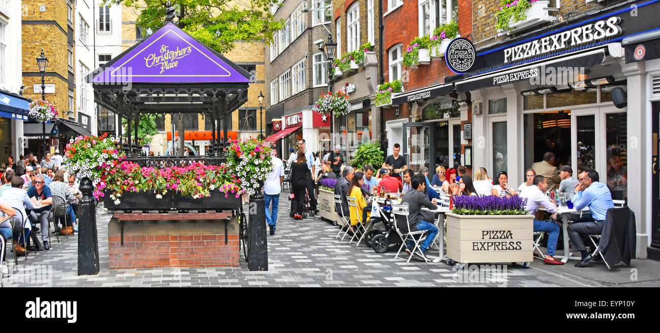Pizza Express pizza restaurant with people eating out dining outdoors in St Christophers Place off Oxford Street - Stock Image