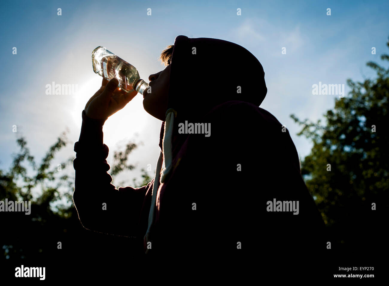 Teenager with Vodka. - Stock Image
