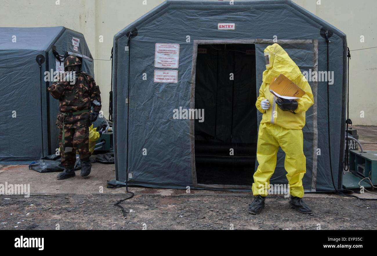 Kolkata, Indian state West Bengal. 2nd Aug, 2015. Indian security personnel take part in a drill on chemical, biological, - Stock Image