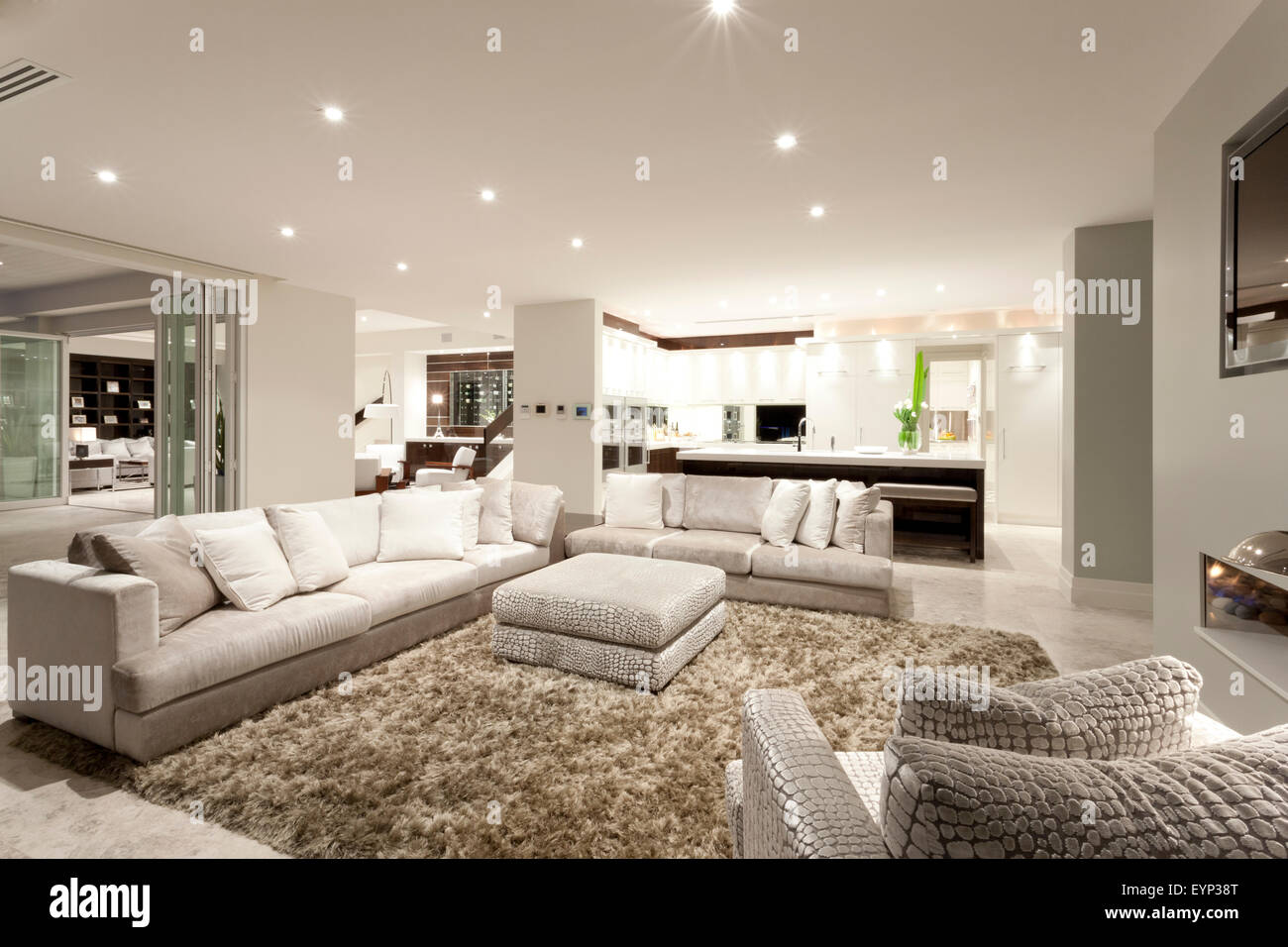 Cozy living room with two spacious sofas, an armchair and a ...