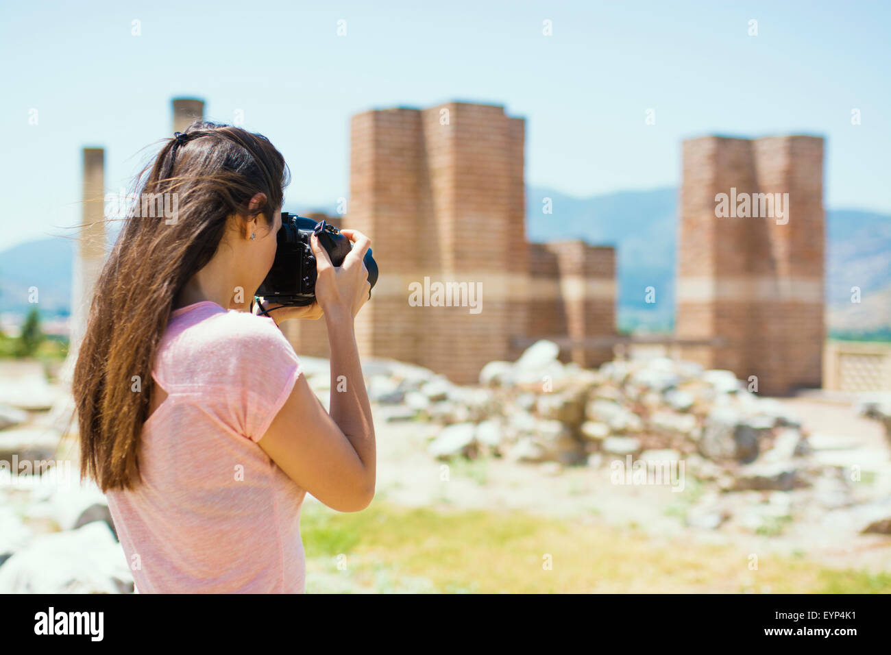 Beautiful young photography take photos outdoors in park - Stock Image