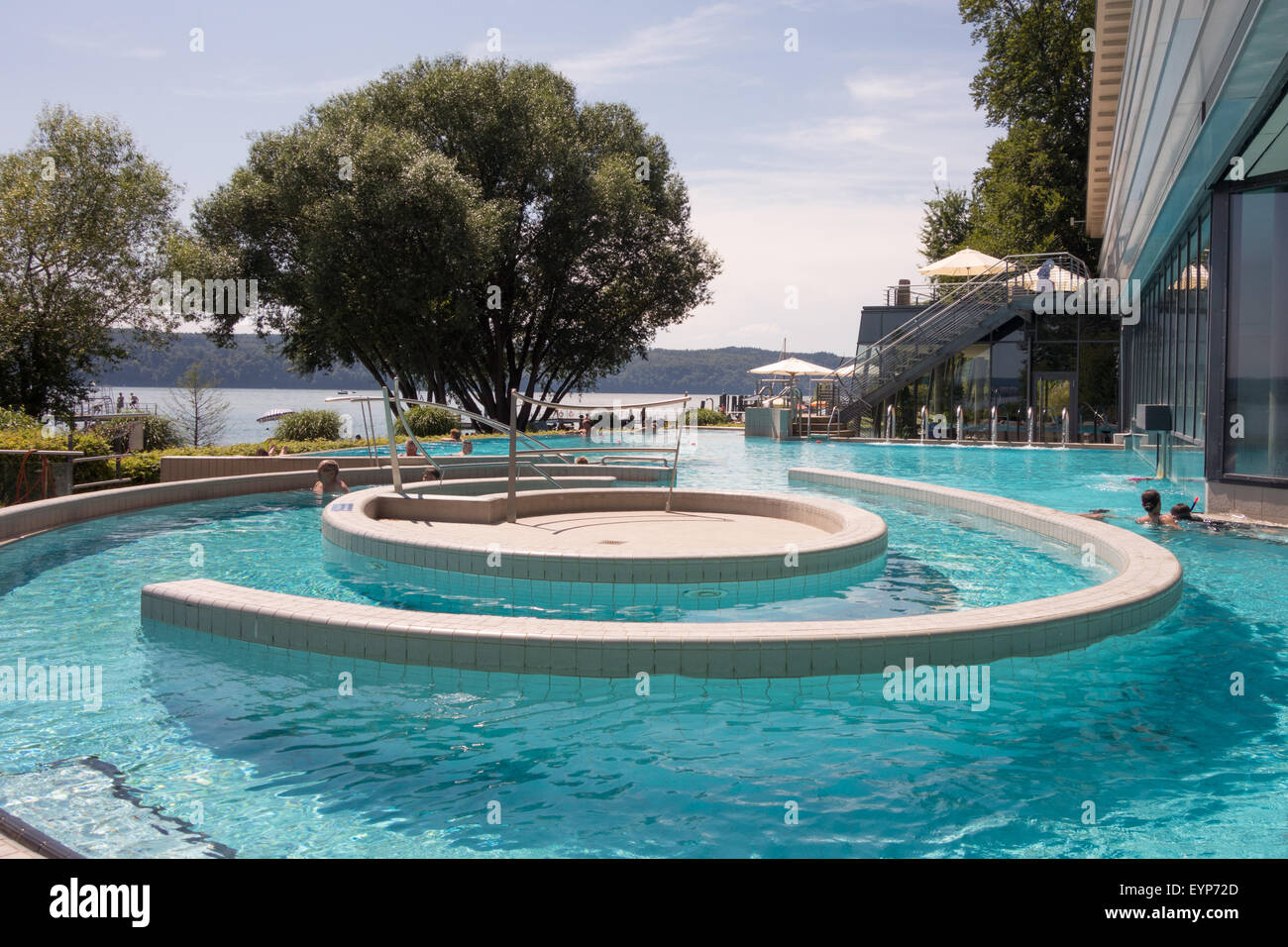 hot springs at Bodensee-Therme, Uberlingen, Germany, with the beach and Lake Constance beyond Stock Photo