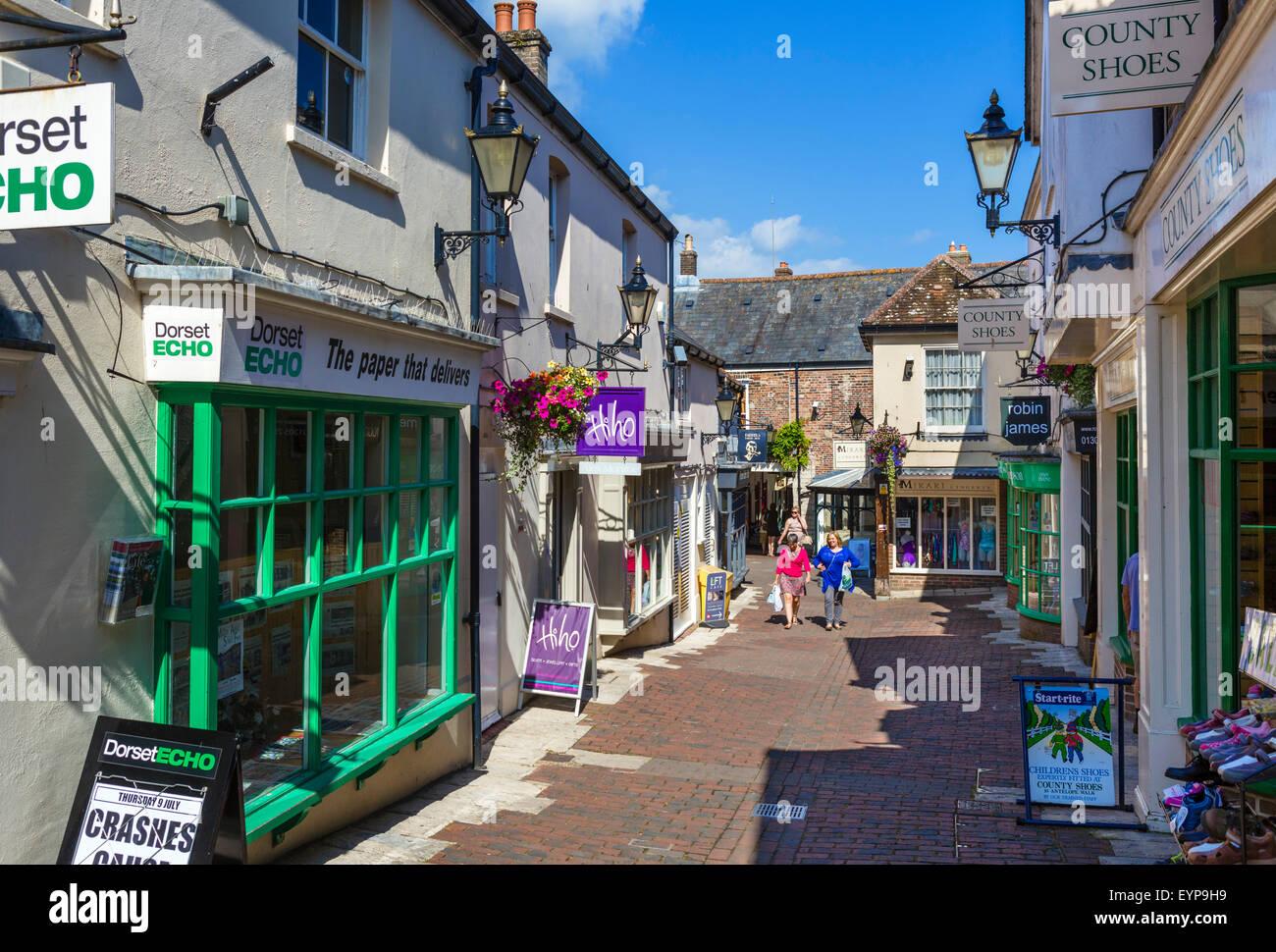 Shops on Antelope Walk in the town centre, Dorchester, Dorset, England, UK - Stock Image