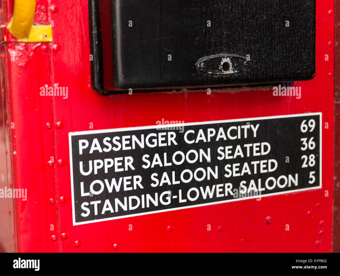 Capacity sign at entry of classic red Routemaster double-decker bus in London, England, UK - Stock Image