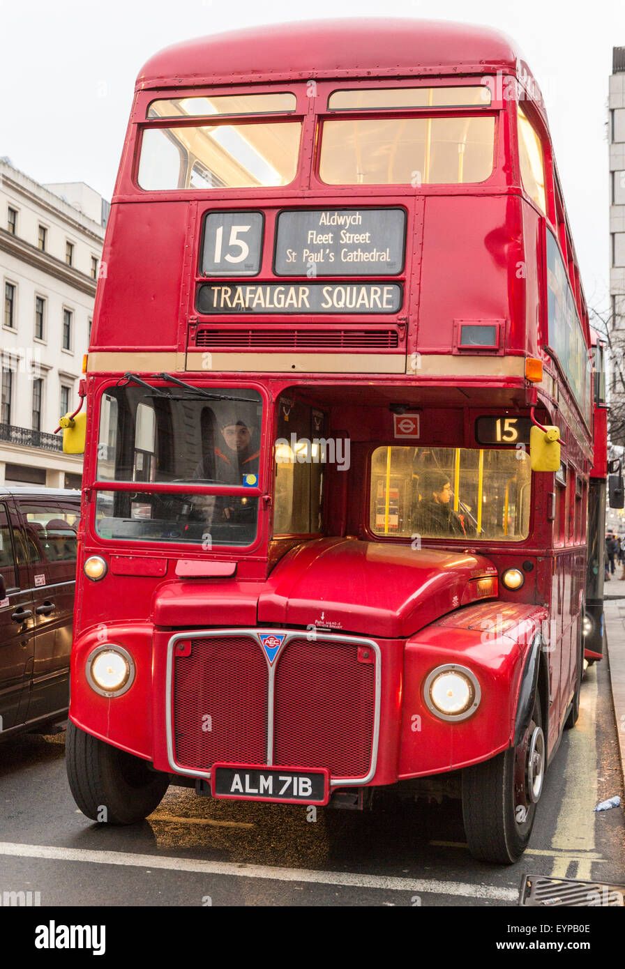 Classic Routemaster red double-decker bus at a stop on the Strand, London - Stock Image