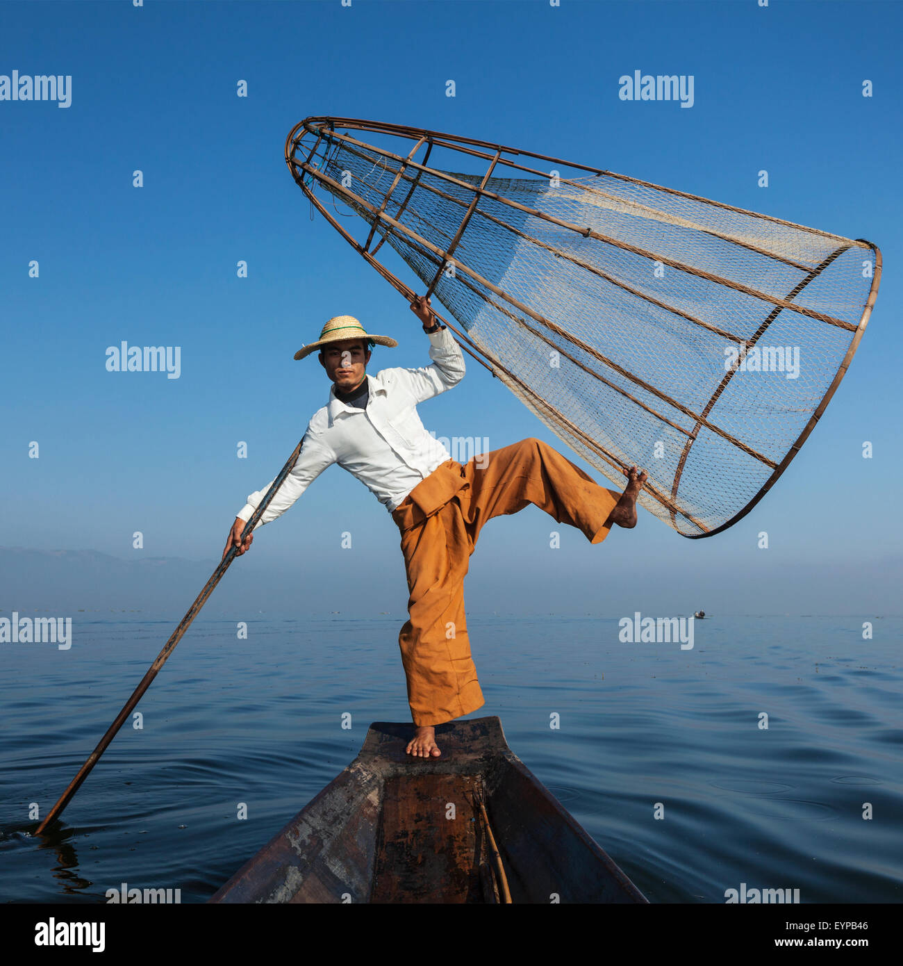 Burmese fisherman at Inle lake, Myanmar - Stock Image