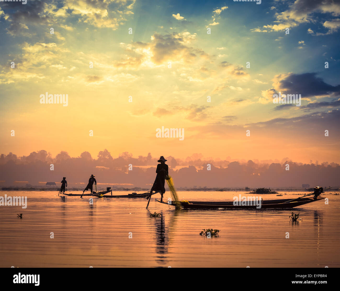 Traditional Burmese fishermen at Inle lake Myanmar - Stock Image