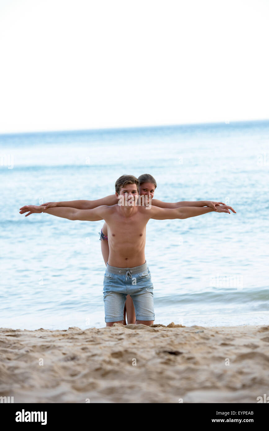 Happy young couple having fun together during summer holidays - Stock Image