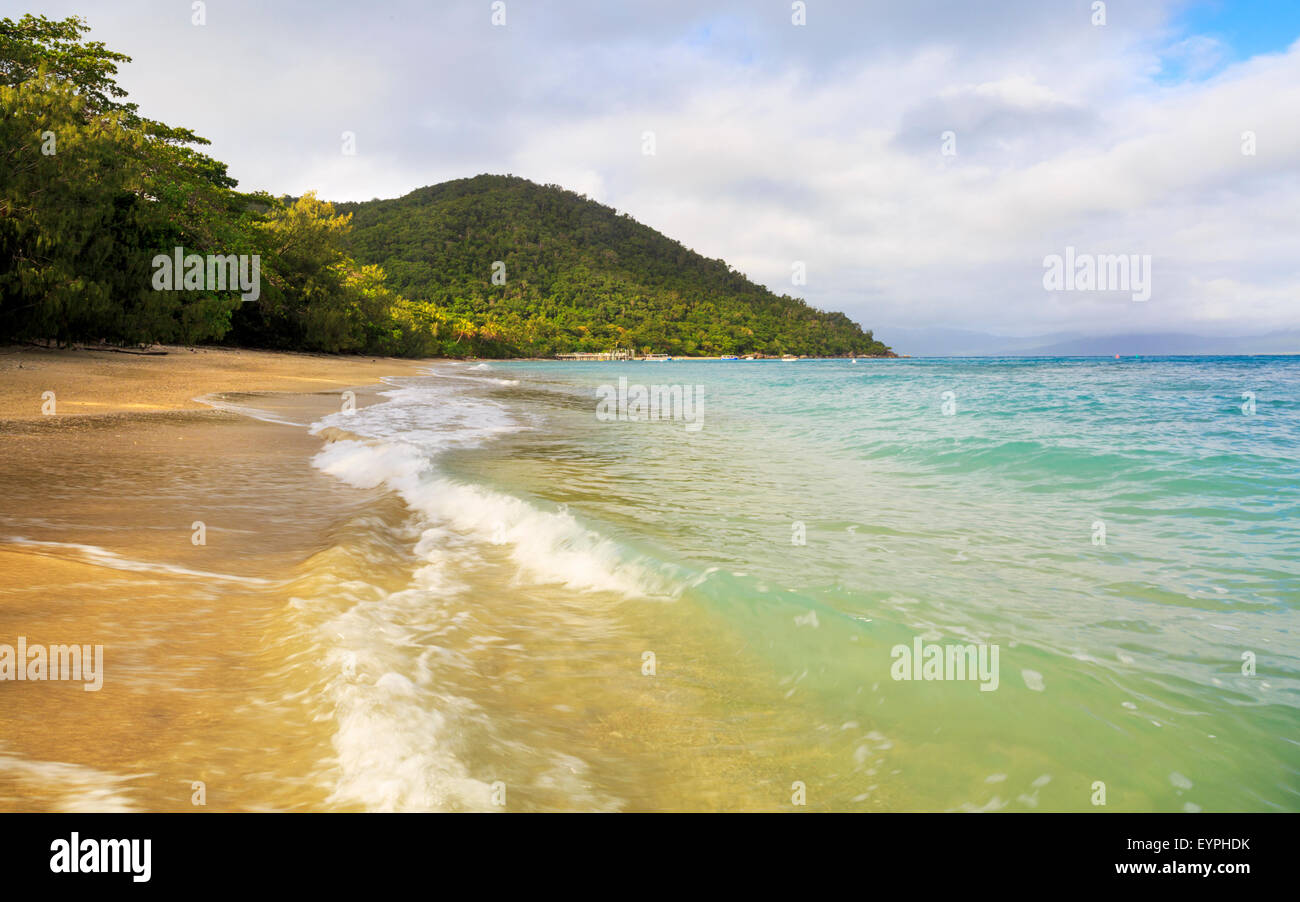 Waves breaking on the beach at Fitzroy Island, Queensland, Australia - Stock Image