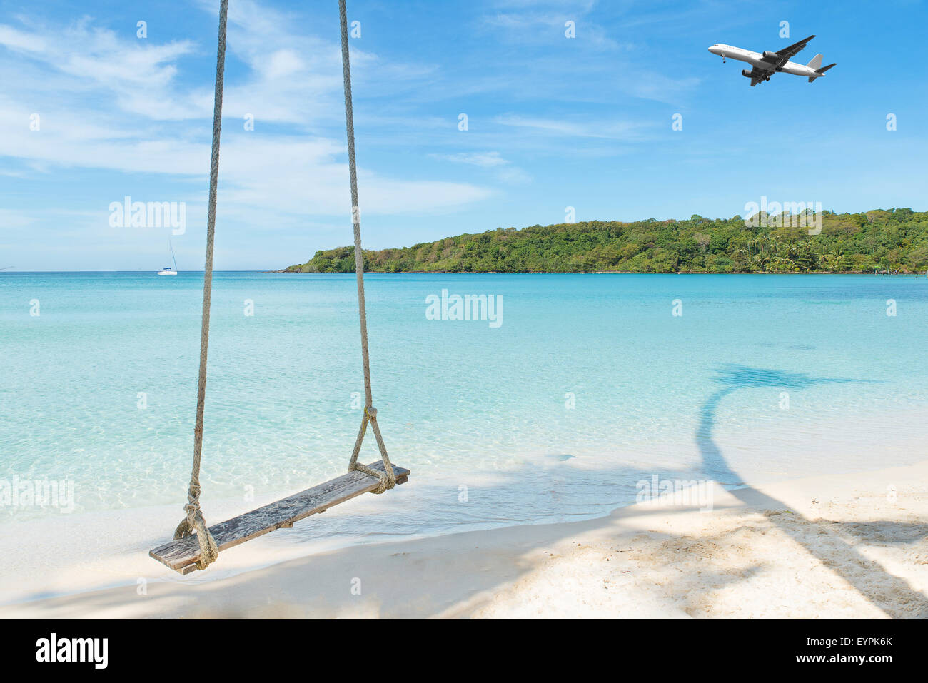 Summer, Travel, Vacation and Holiday concept - Airplane arriving tropical beach sea in Phuket ,Thailand. Stock Photo