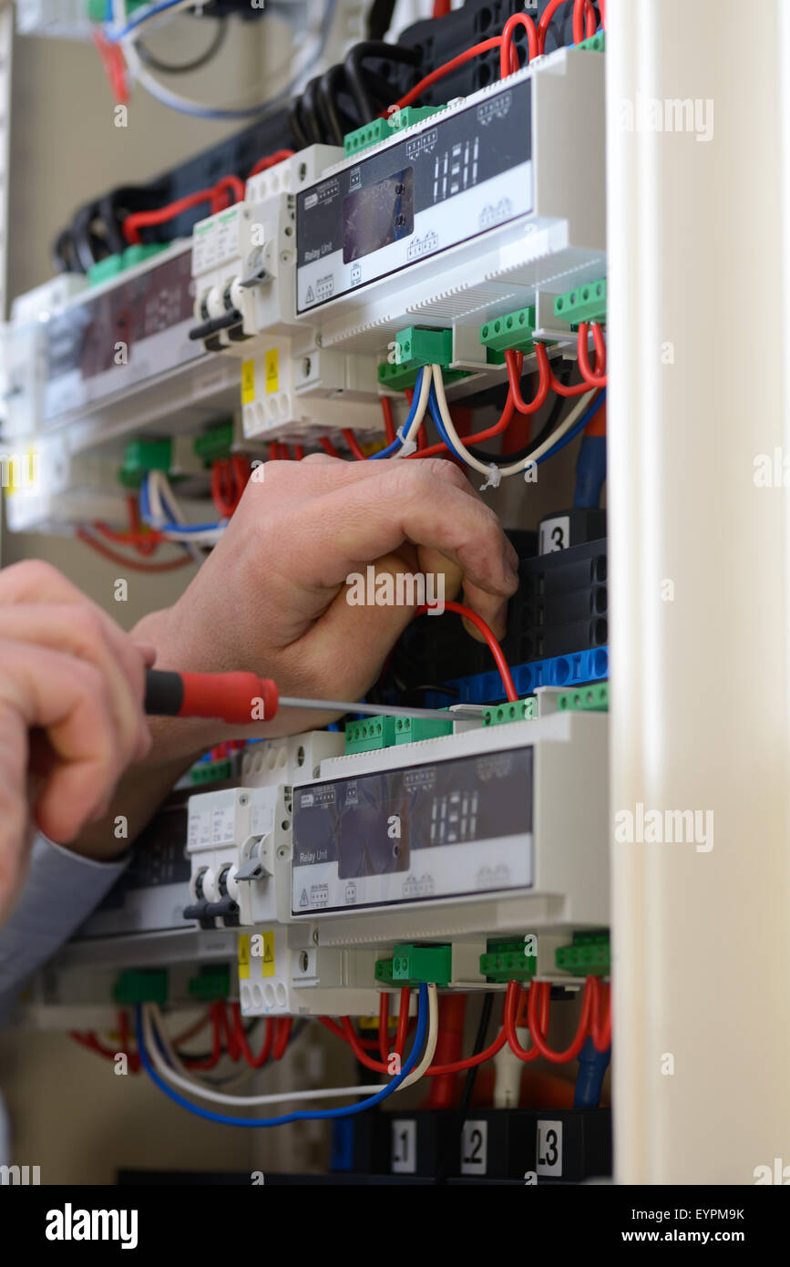 electrician wiring up a switchboard in a new building stock photo rh alamy com