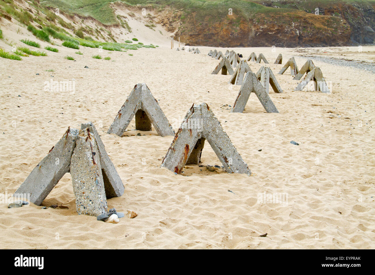 Concrete obstacles on the beach of Brittany, France, remainders of the Atlantic Wall - Stock Image