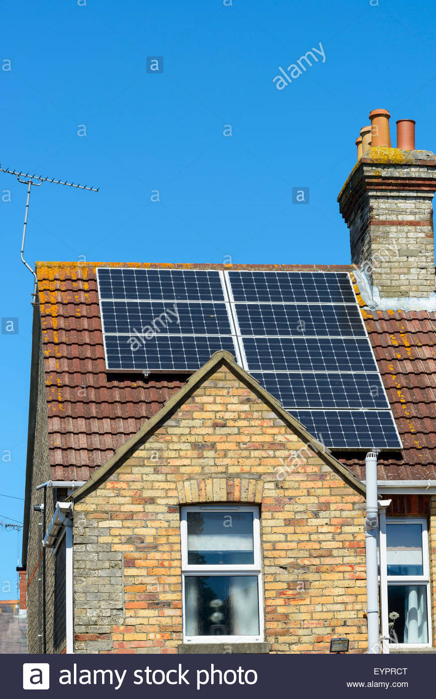 Solar panels on house roof, Poole, Dorset, England, UK - Stock Image