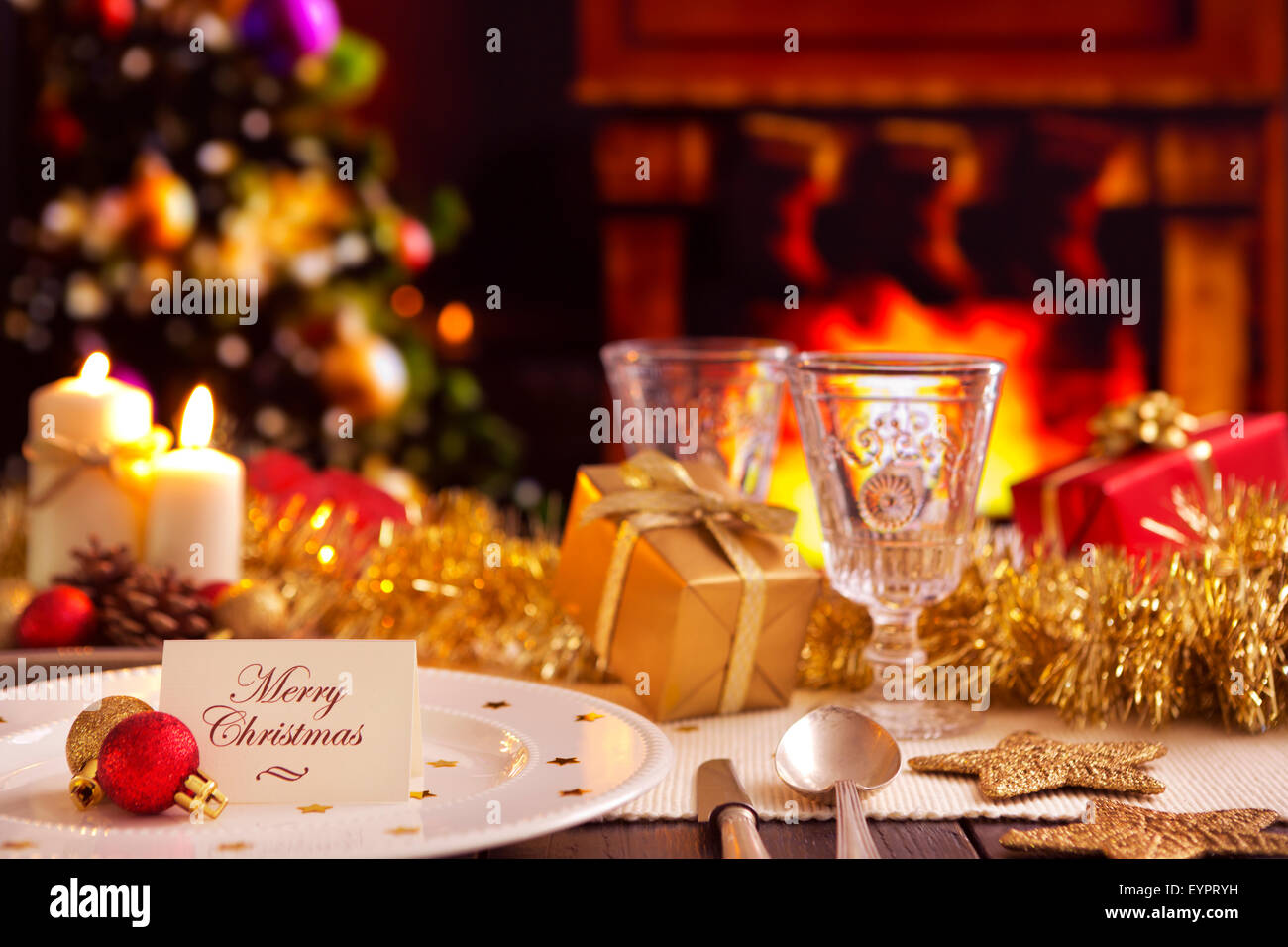 A romantic Christmas dinner table setting with candles and Christmas ...
