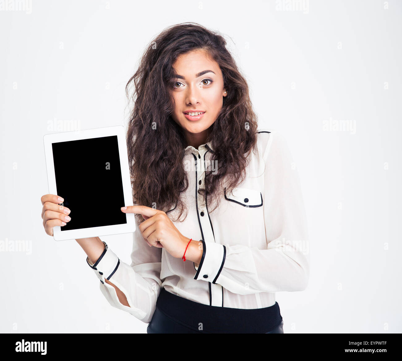 Happy businesswoman pointing finger on tablet computer isolated on a white background. Looking at camera - Stock Image