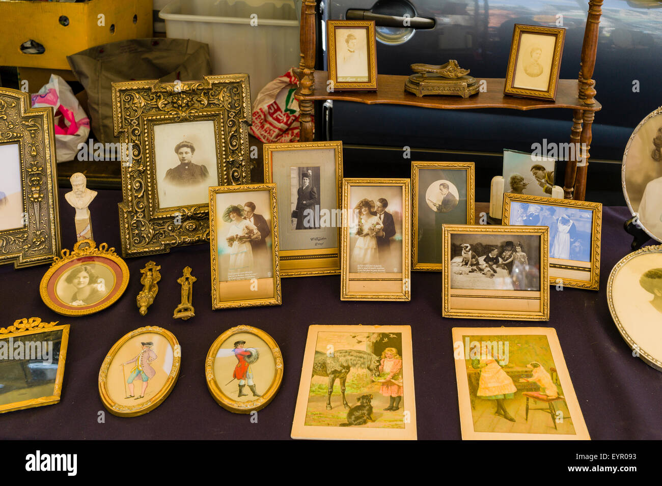 Old family photographs and other mementos photographed in a flea market in Antwerp, Belgium. - Stock Image