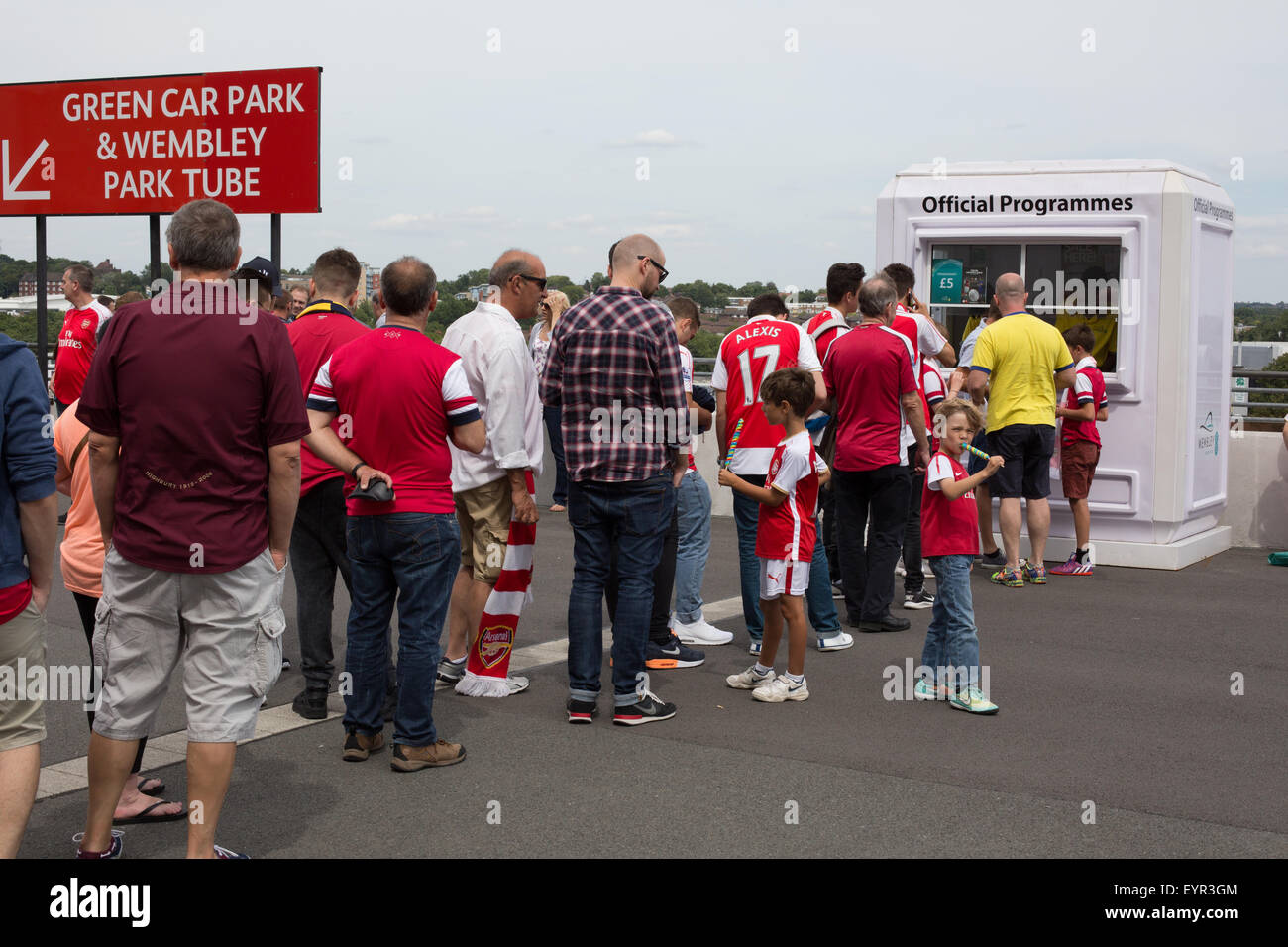 Arsenal football supporters queuing to buy official programmes - Stock Image