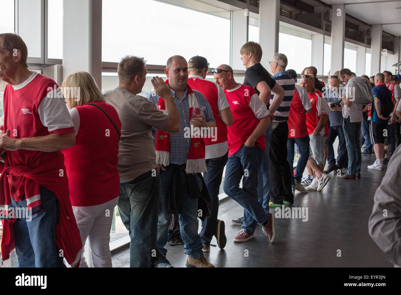 Football supporters drinking and eating at Wembley stadium before a match. - Stock Image