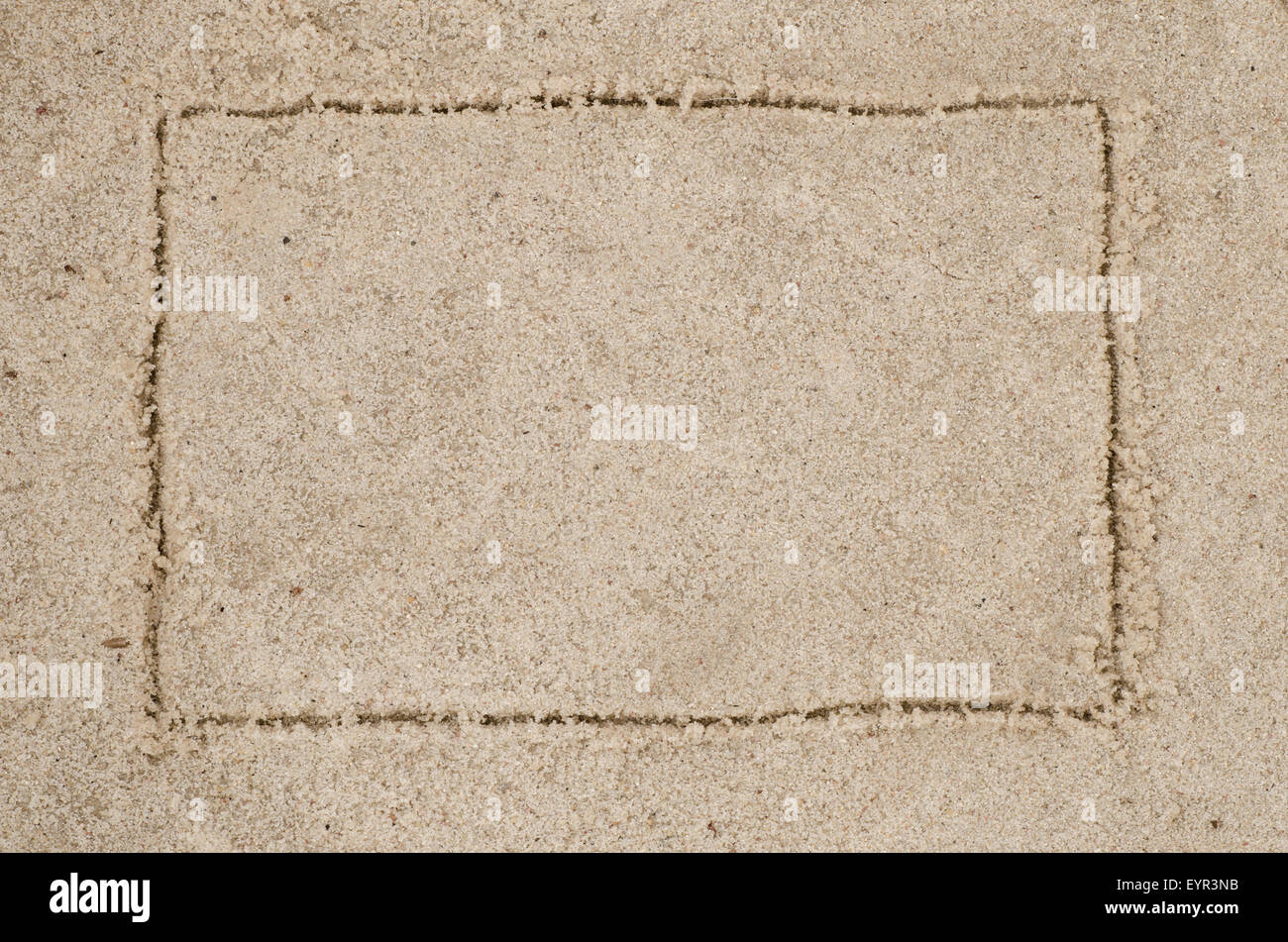 empty frame drawing on sand - Stock Image