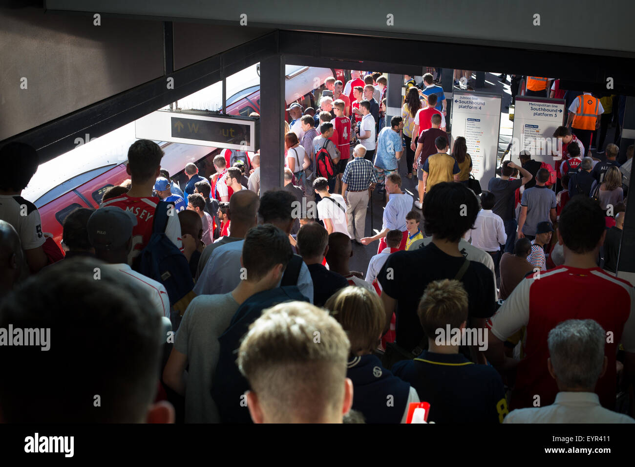 Football supporters at Wembley Park Station after the Community Shield - Stock Image