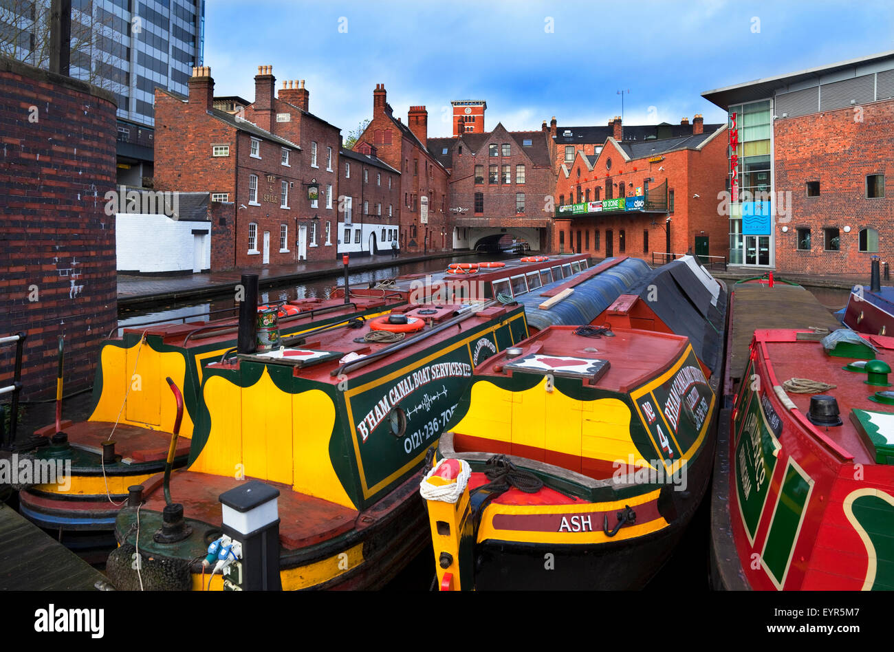 Canal Narrow Boats at the Gas Street Canal Basin part of the Birmingham-Worcester Canal, Birmingham City Centre, - Stock Image