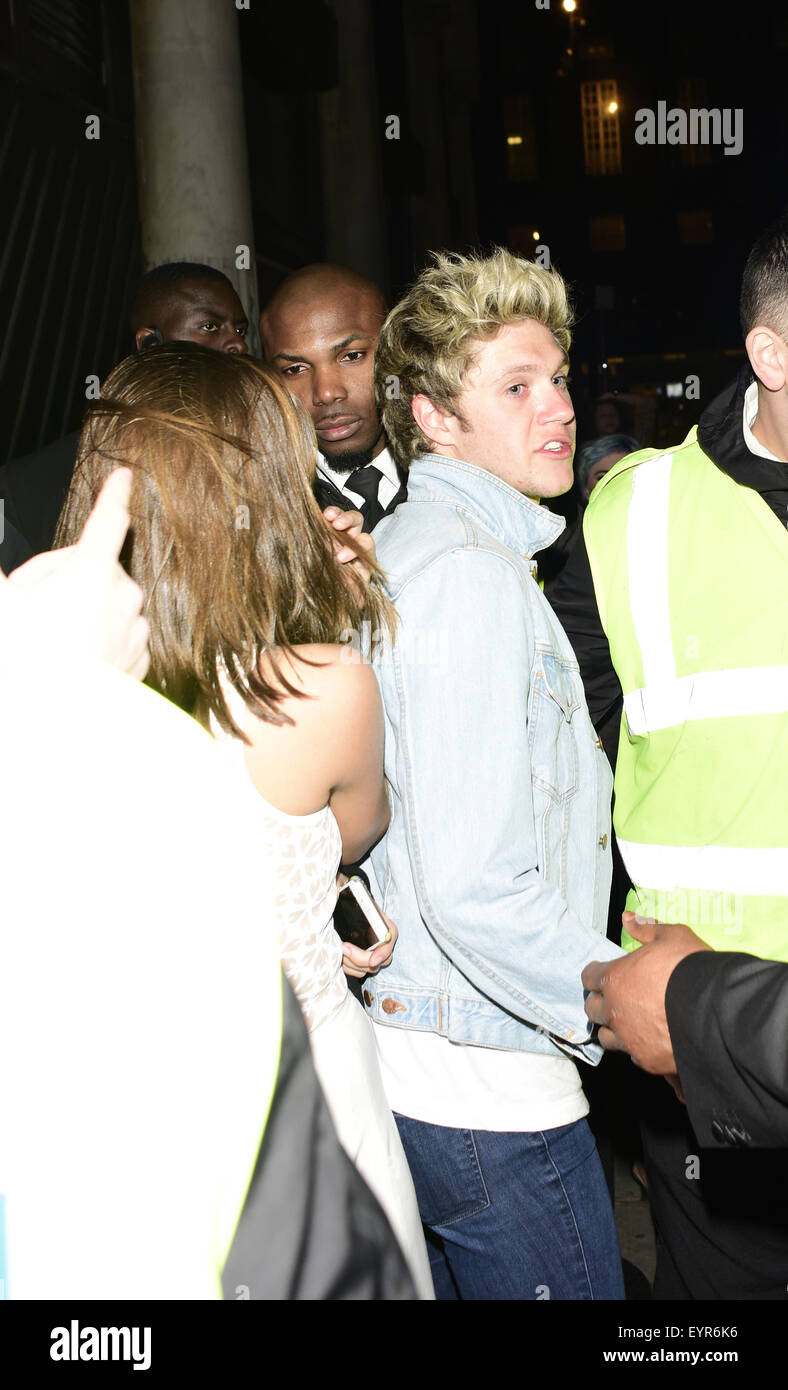 Niall Horan leaving Libertine Club with a mystery woman  Featuring: Niall Horan Where: London, United Kingdom When: - Stock Image