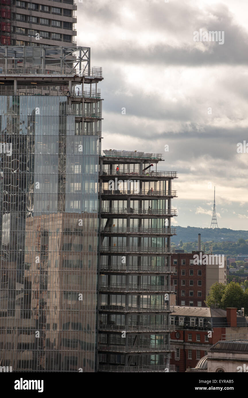 London, England. Reflection in a modern building under construction with the Crystal Palace television transmitter - Stock Image