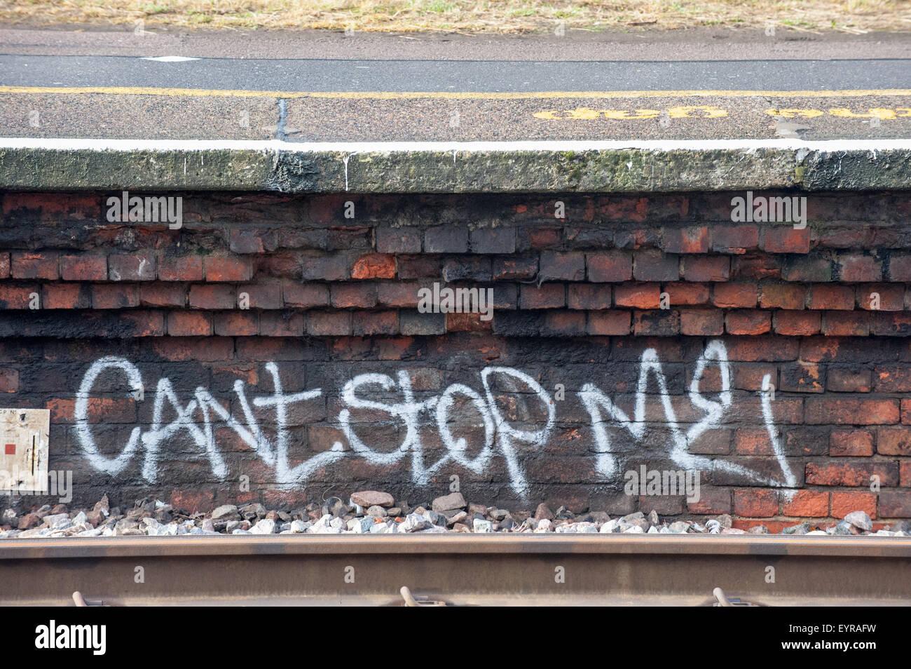 Norbiton station, Surrey. Graffitti 'Can't stop me' under the platform. - Stock Image