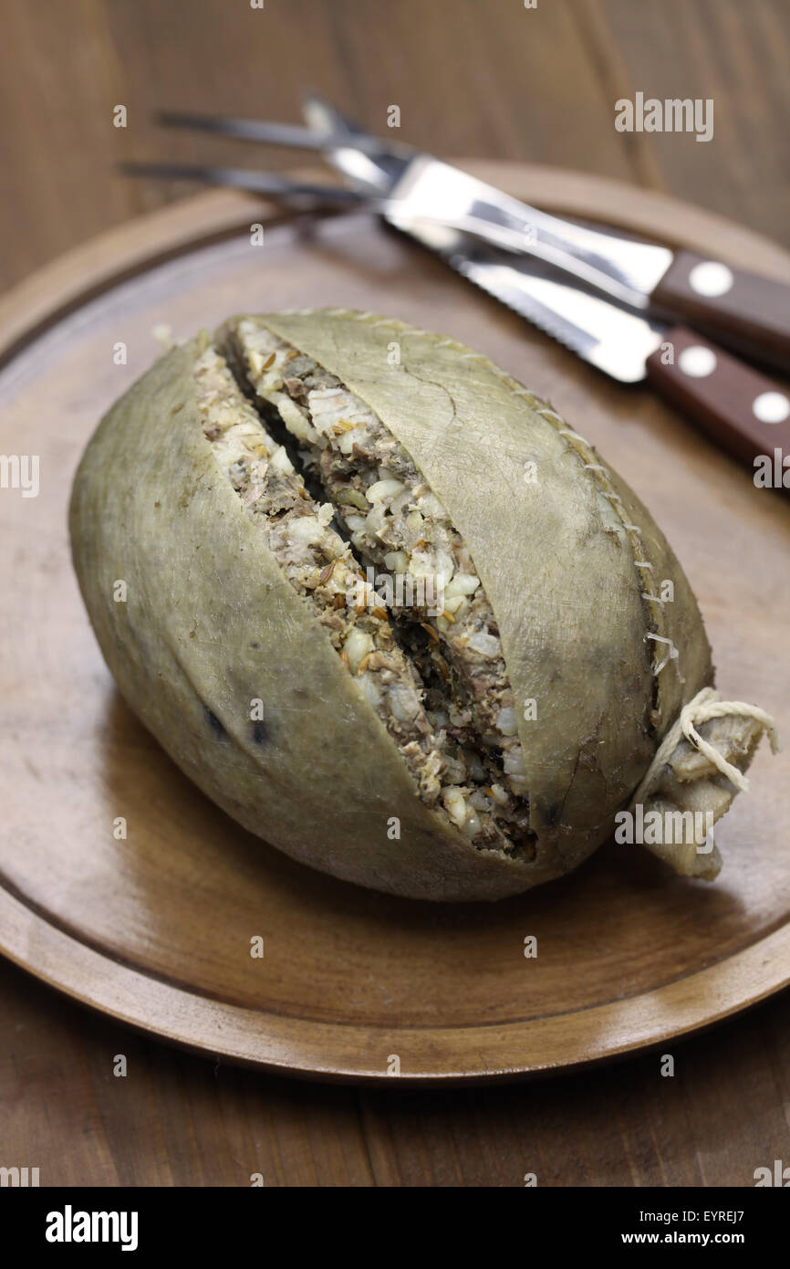 homemade haggis, scotland food isolated on wooden background - Stock Image