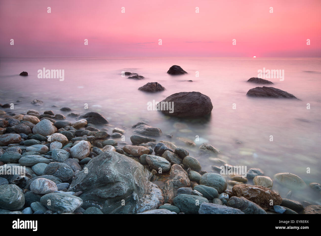 Sunrise viewed from the Papa Nero beach at Agios Ioannis in the Pelion, Greece - Stock Image