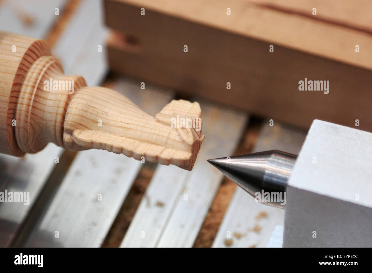 Making chess pieces out of wood on lathe. - Stock Image