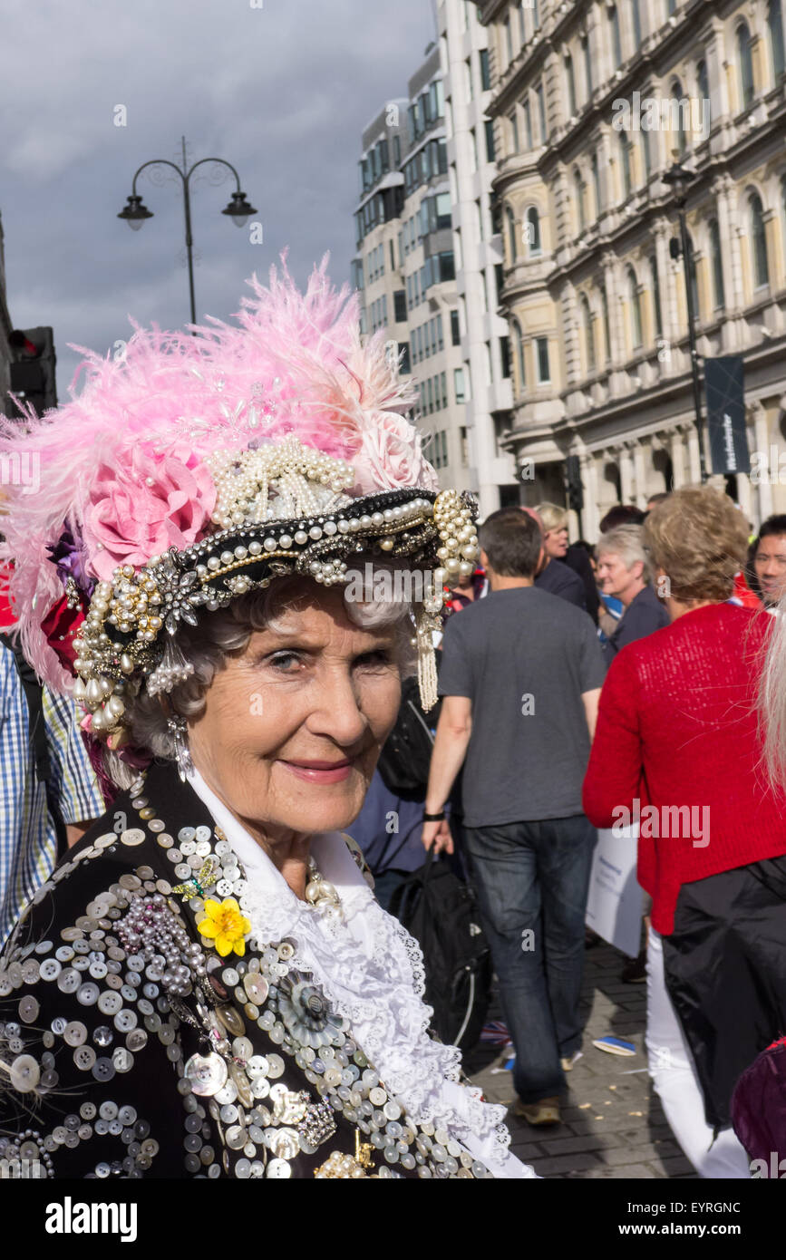 Trafalgar Square, London, Engand. A smiling 'Pearly Queen' in the crowds. - Stock Image
